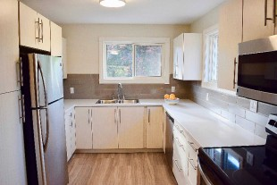 Beautifully renovated unit in quiet two storey triplex